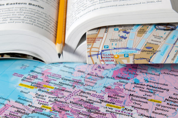 Travel map with book.